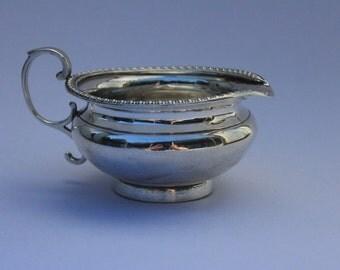 Antique silver creamer - Goldsmiths & Silversmiths Co.