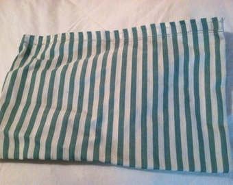 Green and white striped makeup bag with Velcro closure