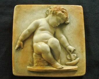Cast stone cherub or chubby child