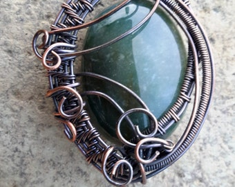 Wire wrapped green glass cabochon