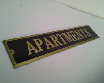 Room with a view please......old brass apartments sign