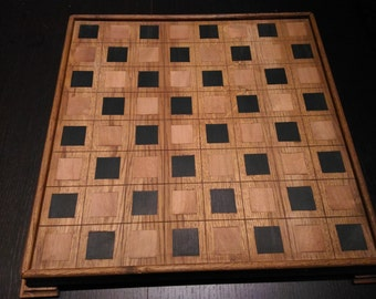 Oak wooden chessboard and chess in bronze