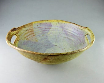Large Stoneware bowl with handle cutouts