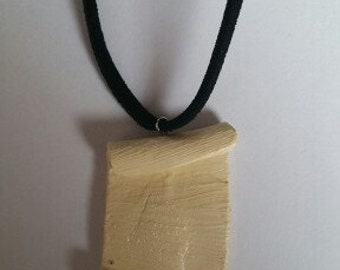 Necklace with piece of parchment