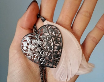 Heart and feather necklace