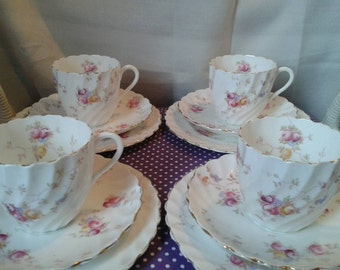 Set of 4 unmarked china transfer floral patterned trios.