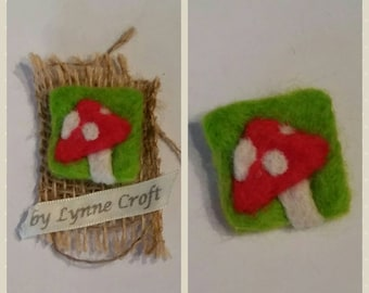 Needle felted toadstool brooch.