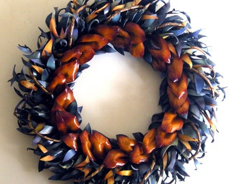 Punahou leather wreath: cut, decorated, molded, dyed, and finished by hand. 21 x 21 inches; 3.5 lbs.; 250+ pieces of leather