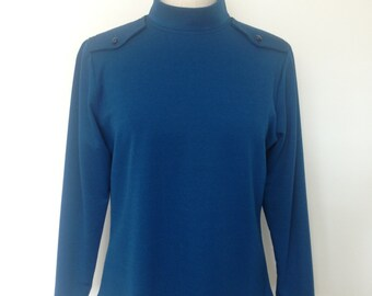 Wool jersey long sleeve top, polo neck, zipper at back