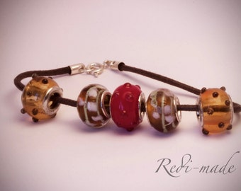 Bracelet - red and brown beads on a brown cord (#259488)