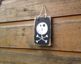 JOLLY ROGER. Hand painted sign.