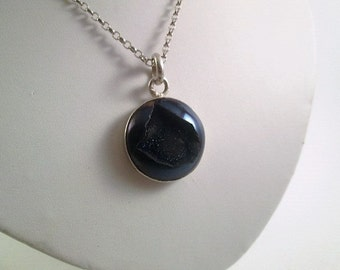Dark blue druzy cabochon pendant mounted in fine and sterling silver.