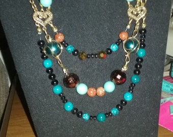 Brown/turquoise/gold twisted strand necklace