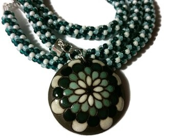 Blue Flower Pendant On A Kumihimo Necklace