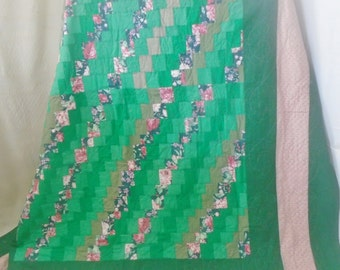F101 - Full size bed quilt in greens and pinks.