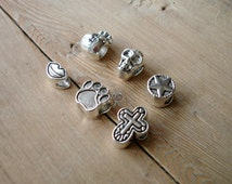 6 assorted charm beads in antique silver tone M2