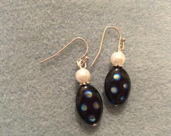 Black dotted dangle earrings