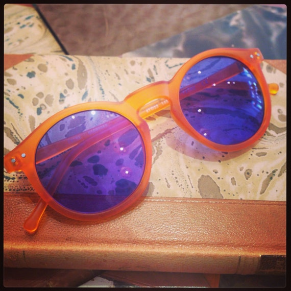 Retro sunglasses: Orange frosted with blue glass.