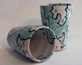 Funky ceramic tumblers, pint glasses, Dr. Suess style, green and white