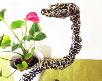 blue/gold standing snake