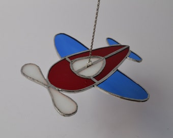 Stained glass suncatcher red, white and blue airplane hanging from silver steel chain