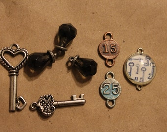 Seven charms and connectors: steampunk keys, jewels, and numbers