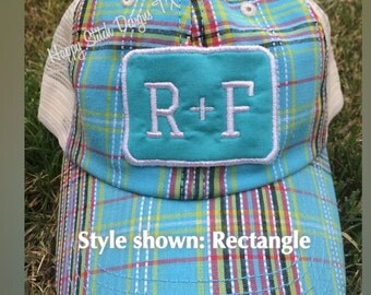 R+F patch on plaid trucker hat