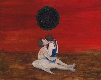 Couple kissing in dry field
