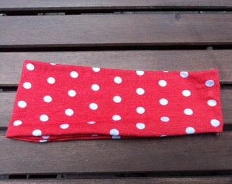 Wide headband with stretch fabric. Red with white dots.
