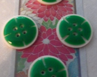 Lot of Four Celluloid Overlay Buttons   White and Green