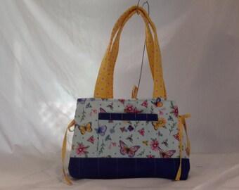Mini bow tucks purse