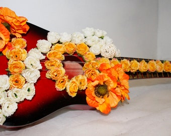 Guitar with artificial flowers