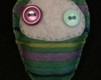Ambiguous creature plush - striped green