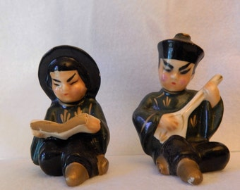 Vintage Chinese Man and Woman Salt and Pepper Shakers.