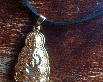 Gold buddha on leather