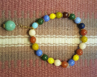 Multicolor glass beads with green drop