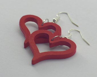 Wooden earrings in bright red heart