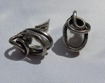 Earrings steel earrings with inclusion of rock crystal.