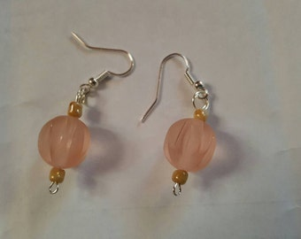 Pink and gold dangle earrings