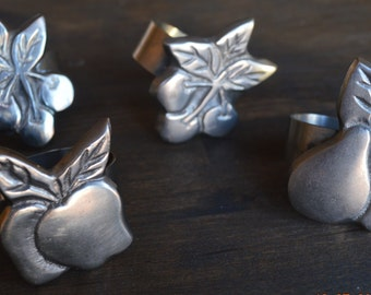 Set of Four Silver Fruit Napkin Rings