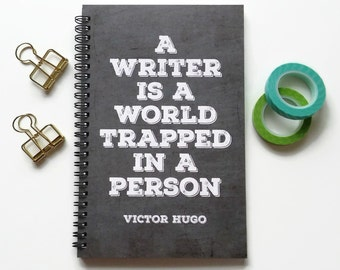 Writing journal, spiral notebook, bullet journal, cute notebook, diary sketchbook blank lined grid - A writer is a world trapped in a person