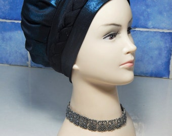 headcover tobe in the color blue with a braid and sparkles
