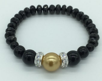 Black Onyx and Rondelles with a Mother of Pearl in Gold
