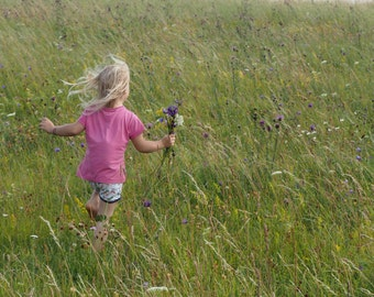 A Photo: Girl running in a field
