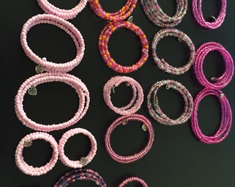 Pink Bracelets Various Shades and Sizes