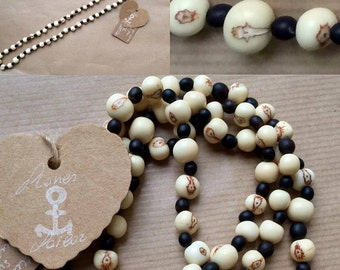 Unisex long necklace in natural Acai seeds and Toloman