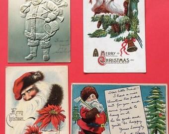 Lot of Four Santa Postcards
