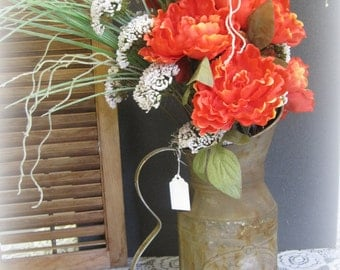 Rustic Pitcher Orange Floral Arrangement