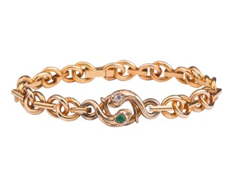 Antique Victorian snake bracelet with emerald and diamonds.