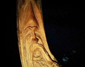 wood carved mans face